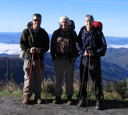 Three hikers prepared for adventure